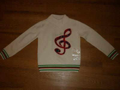 Продам новый свитер на девочку,на рост 116-112.Шерсть.